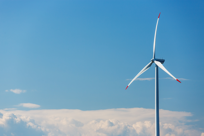 Blue sky and clouds with wind turbines generating electricity